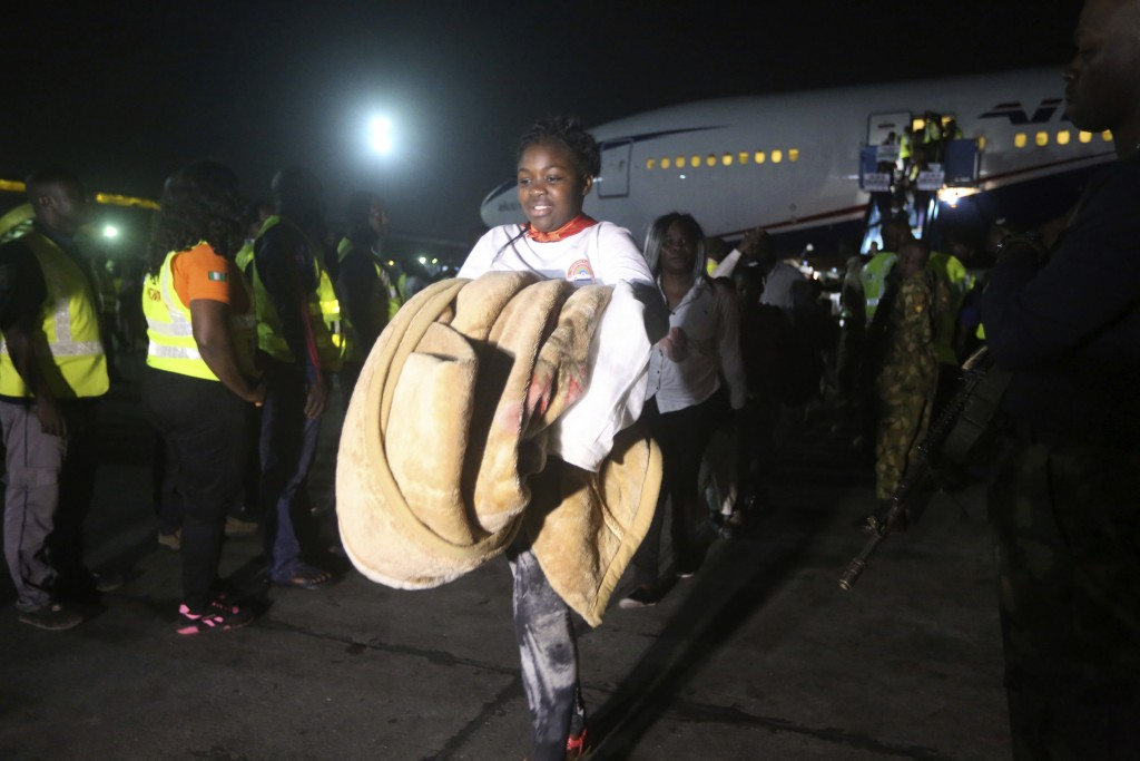 A Nigerian returnee from South Africa due to recently violence targeted at foreigners arrives on an Air Peace airline at the Murtala Muhammed Internat...