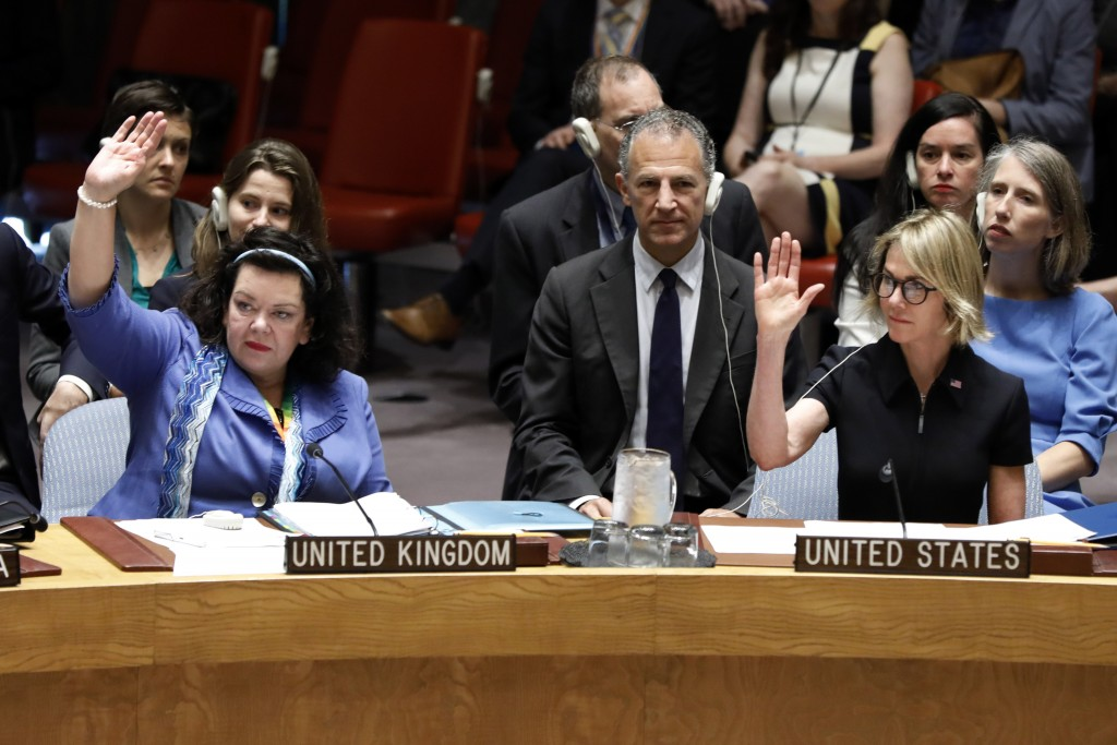 New U.S. Ambassador Kelly Craft, right, and Britain's Ambassador Karen Pierce vote during Craft's first Security Council meeting, at United Nations he