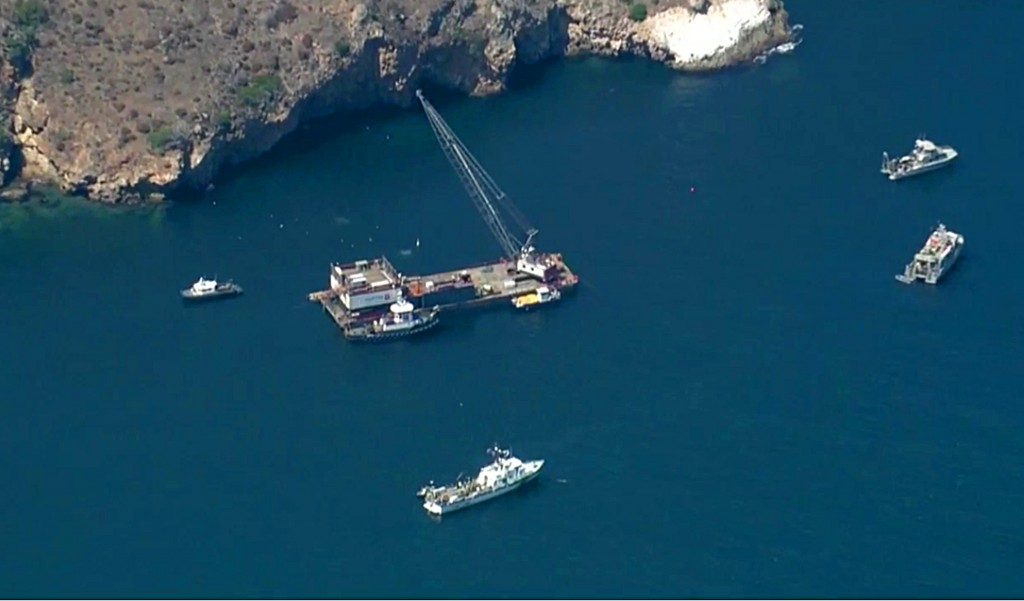 This photo from video provided by KABC-TV shows divers resuming their search Wednesday, Sept. 11, 2019 for the final missing victim who perished in a