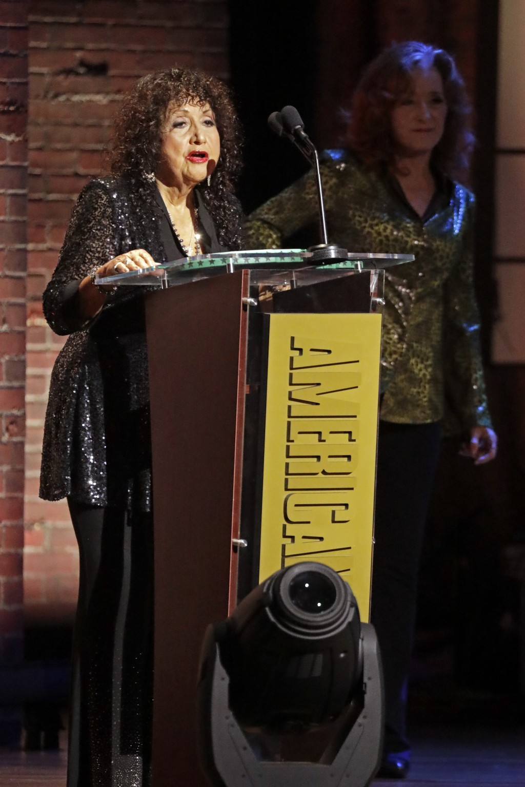 Maria Muldaur accepts the Trailblazer Award after it was presented to her by Bonnie Raitt, right, at the Americana Honors & Awards show Wednesday, Sep