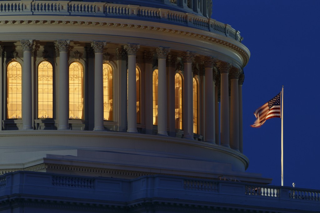 FILE - In this July 16, 2019, file photo an American flag flies on the Capitol Dome in Washington. On Thursday, Sept. 12, the Treasury Department rele