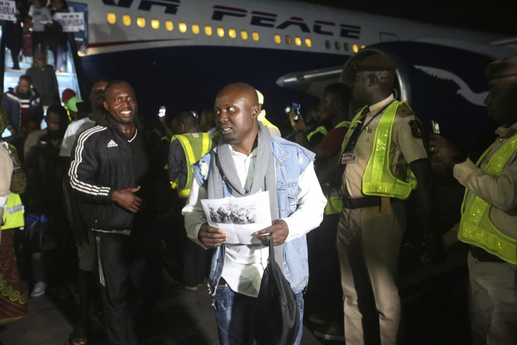 Nigerian returnees from South Africa due to recently violence targeted at foreigners arrive on an Air Peace airline at the Murtala Muhammed Internatio