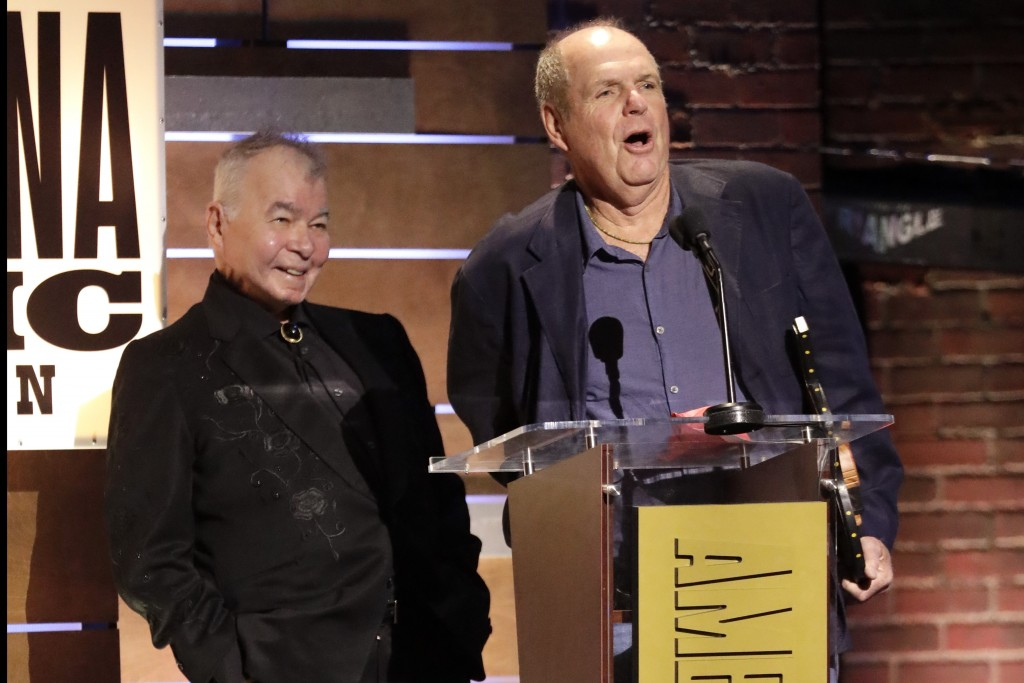 """John Prine, left, and Pat McLaughlin accept the Song of the Year Award for """"Summer's End"""" at the Americana Honors & Awards show Wednesday, Sept. 11, 2"""