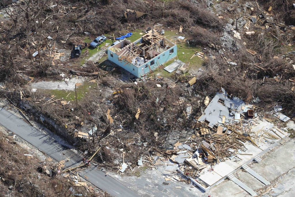 In this handout photo provided by the Dutch Defense Ministry taken on Wednesday, Sept. 11, 2019, the aftermath of Hurricane Dorian is seen on the isla...