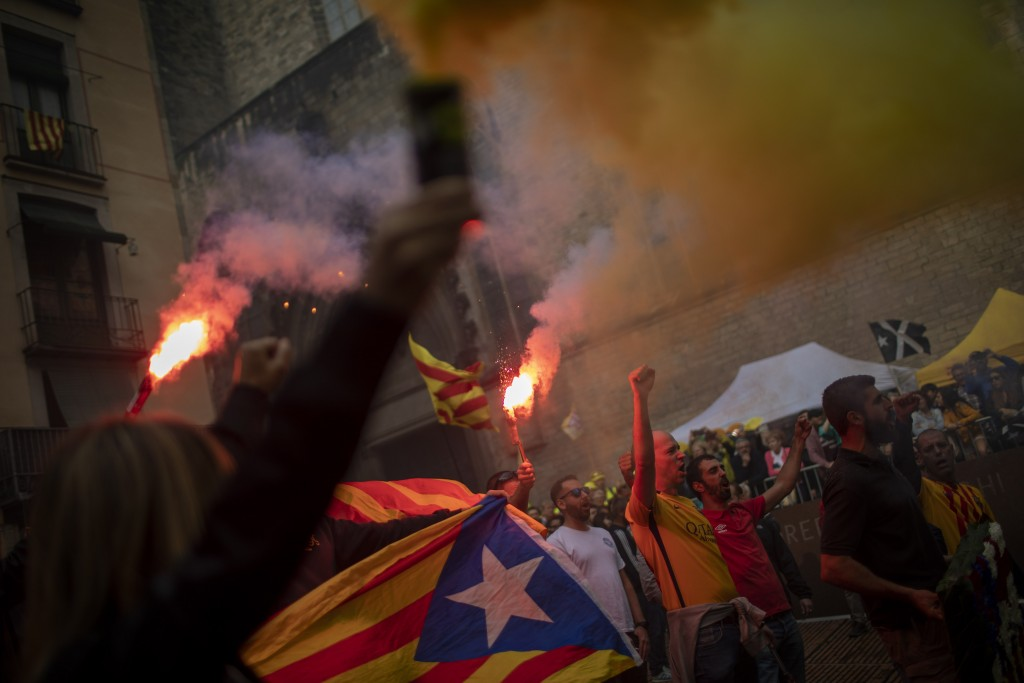Protesters hold independence flags and flares during the Catalan National Day in Barcelona, Spain, Wednesday, Sept. 11, 2019. The traditional Septembe...