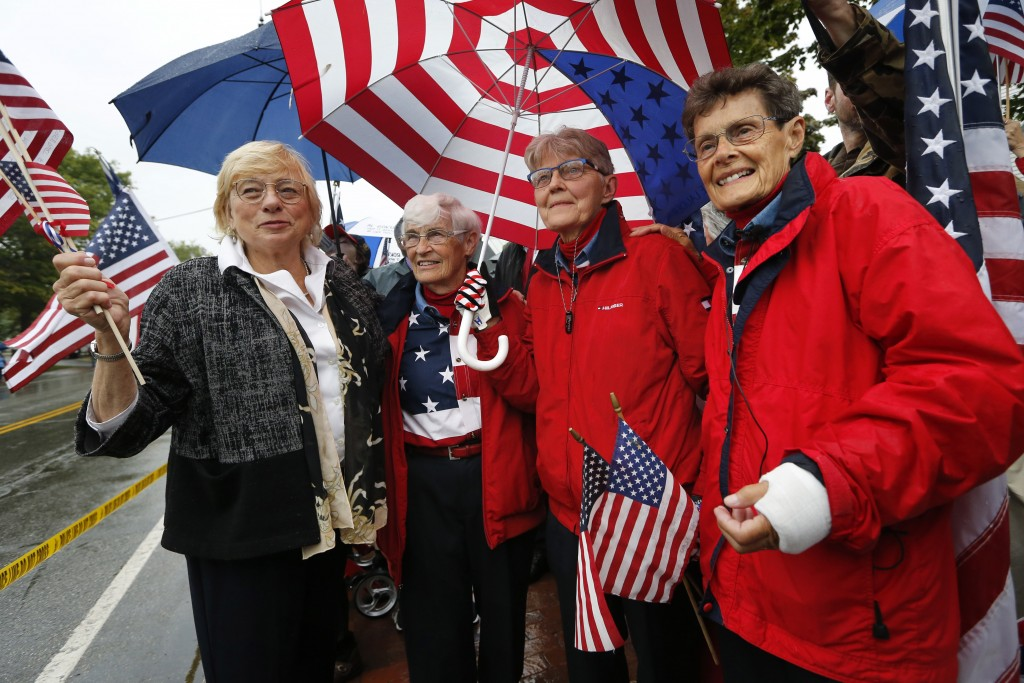 """Maine Gov. Janet Mills, far left, shares a moment with the """"Freeport flag ladies,"""" left to right, JoAnn Miller, Elaine Greene, and Carmen Footer, on M"""