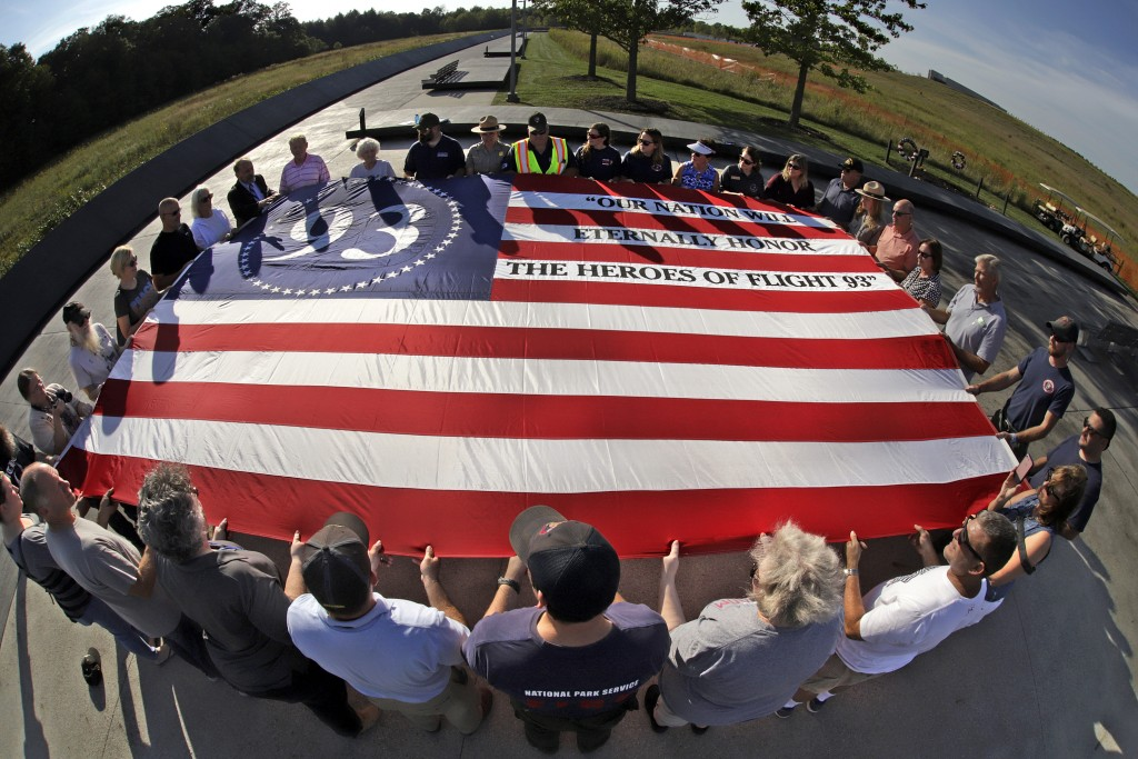 Visitors to the Flight 93 National Memorial in Shanksville, Pa., participate in a sunset memorial service on Tuesday, Sept. 10, 2019, as the nation pr