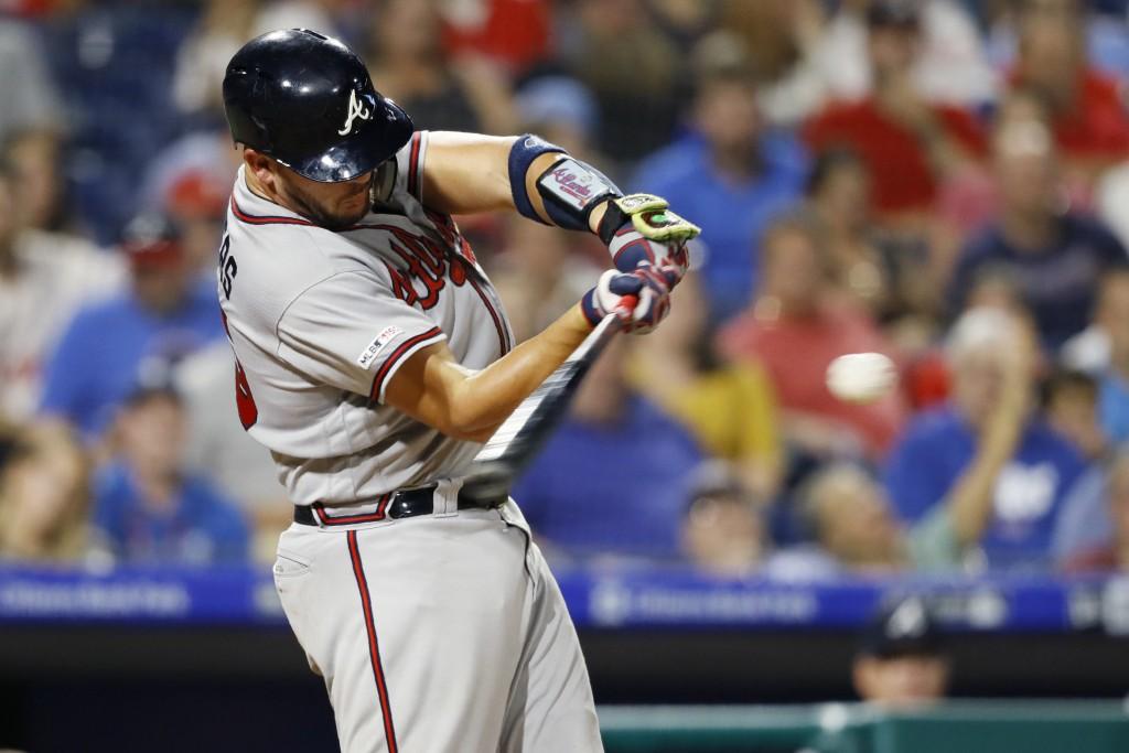 Atlanta Braves' Tyler Flowers hits a three-run home run off Philadelphia Phillies starting pitcher Zach Eflin during the fourth inning of a baseball g...