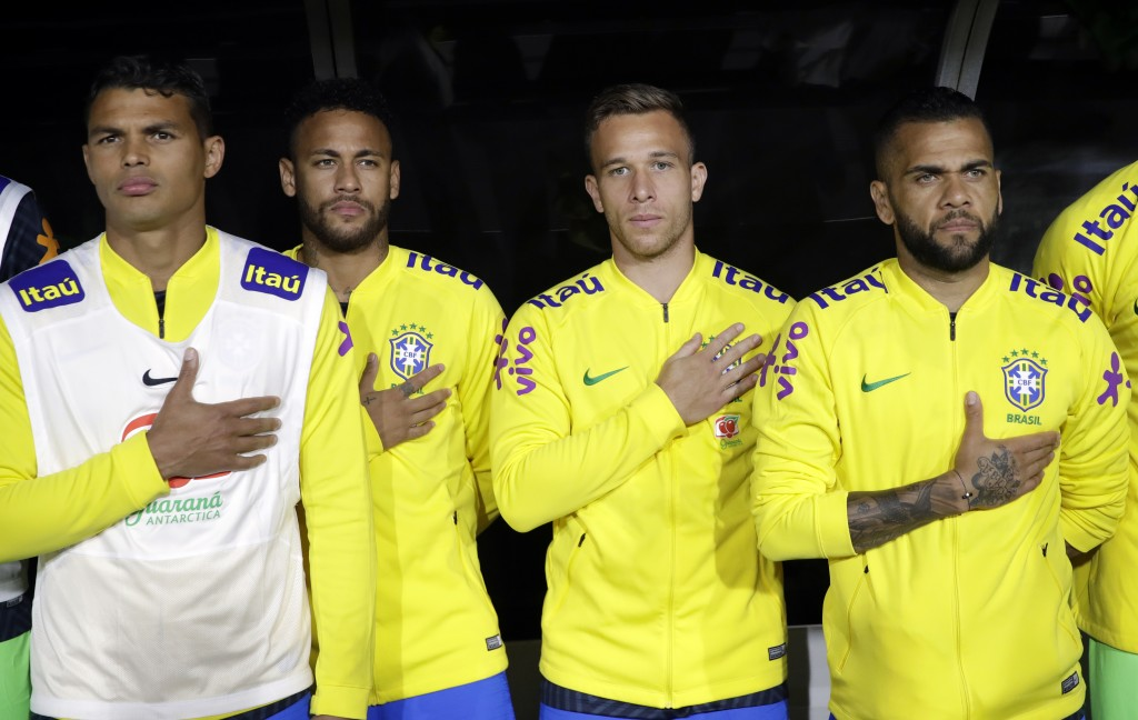 Brazil players listen to their national anthem before an international friendly soccer match against Peru on Tuesday, Sept. 10, 2019, in Los Angeles. ...