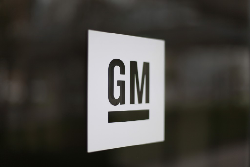 FILE - This May 16, 2014, file photo, shows the General Motors logo at the company's world headquarters in Detroit. Under pressure from the federal go...