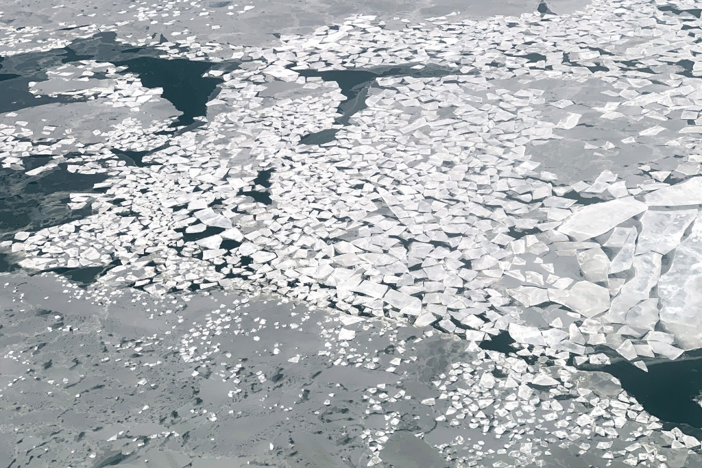 In this Feb. 14, 2019, photo, sheets of ice float in Norton Sound near the Native Village of St. Michael, Alaska, population 400. Transportation in th...
