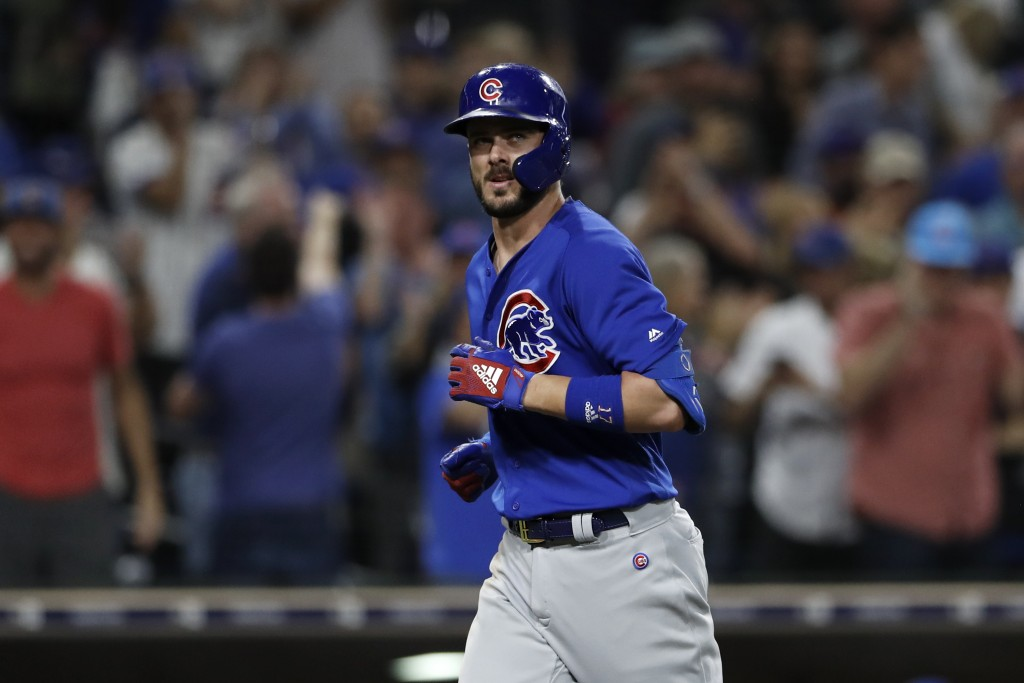 Chicago Cubs' Kris Bryant reacts after hitting a two-run home run during the eighth inning of the team's baseball game against the San Diego Padres on...