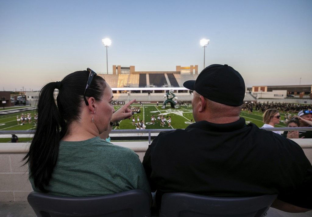 Lisa DeMarco and Rey Martinez watch students on the field during the opening of the new Children's Health Stadium at Prosper ISD on Saturday, Aug. 17,...