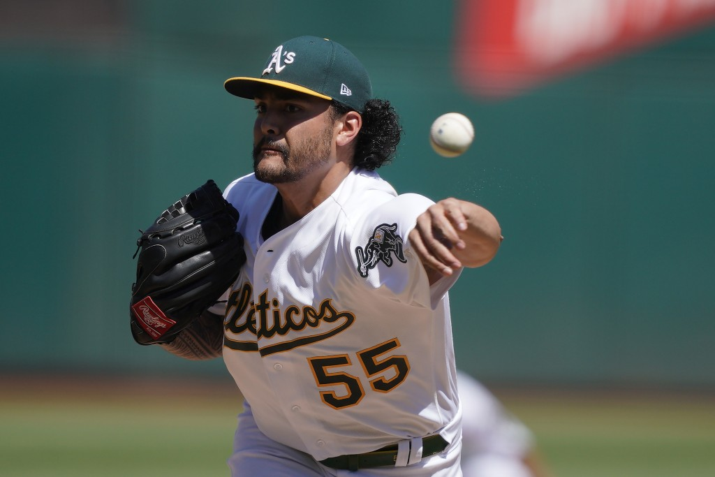 Oakland Athletics pitcher Sean Manaea works against the Detroit Tigers during the first inning of a baseball game Sunday, Sept. 8, 2019, in Oakland, C...