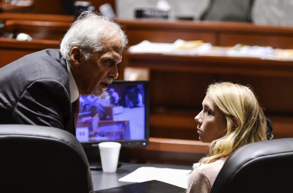 """Brooke """"Skylar"""" Richardson, right, talks to attorney Charles H. Rittgers in the courtroom before closing arguments in her trial at Warren County Commo..."""