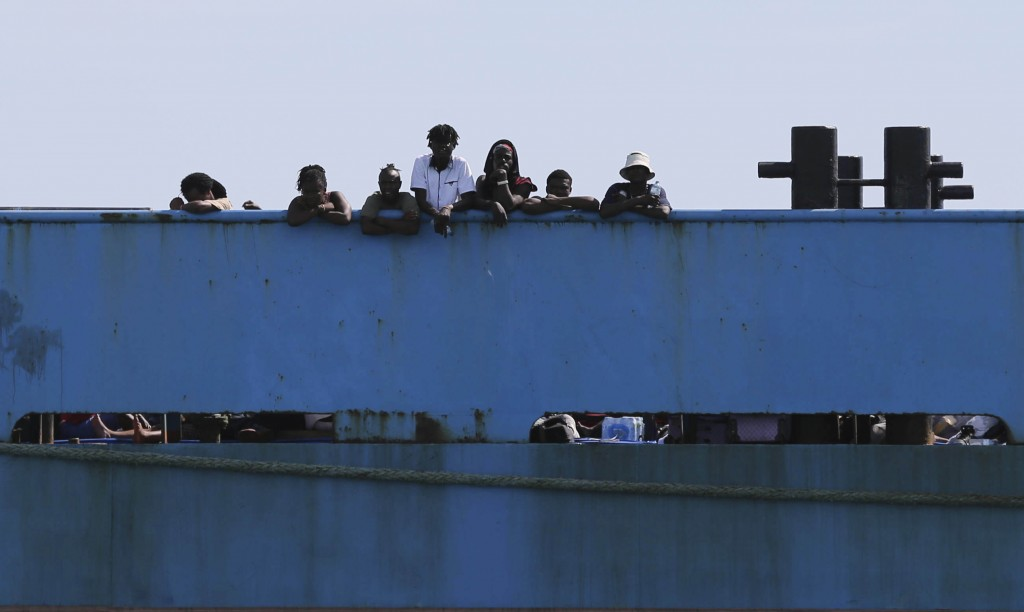 People look out from a ferry as they wait to be evacuated to Nassau in the aftermath of Hurricane Dorian, from the port of Marsh Harbor, Abaco Island,...