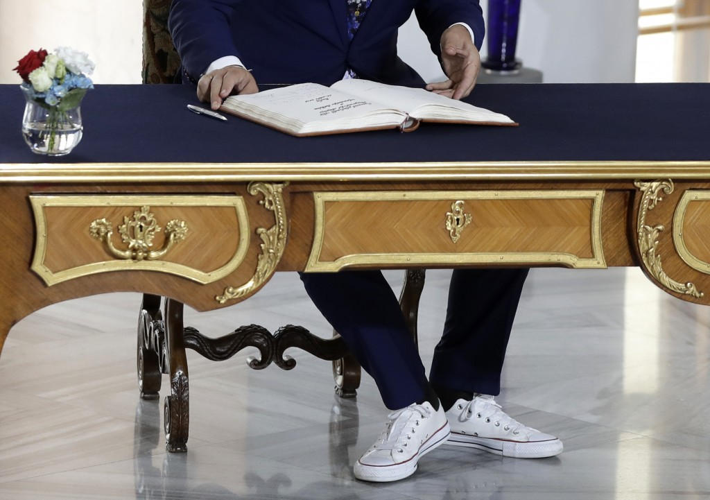 Albanian Prime Minister Edi Rama, wearing sport shoes, signs into a book upon his arrival for the V4+West Balkan summit in Prague, Czech Republic, Thu