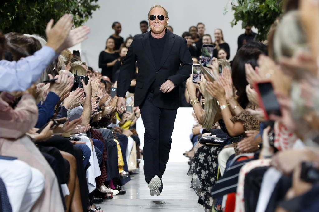 Designer Michael Kors is applauded on the runway after his collection was modeled during Fashion Week in New York, Wednesday, Sept. 11, 2019. (AP Phot...