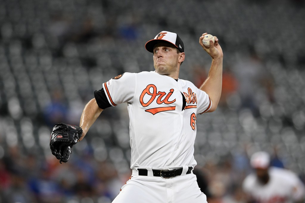 Baltimore Orioles starting pitcher John Means delivers a pitch during the first inning of the team's baseball game against the Los Angeles Dodgers, We...