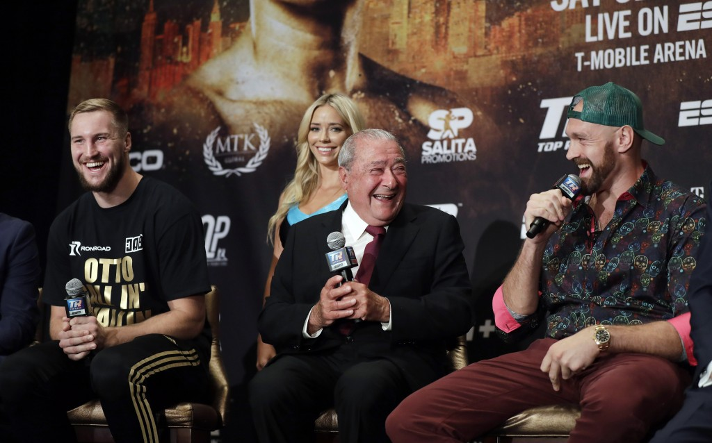Otto Wallin, of Sweden, left, promoter Bob Arum and Tyson Fury, right, laugh during a news conference Wednesday, Sept. 11, 2019, in Las Vegas. Wallin