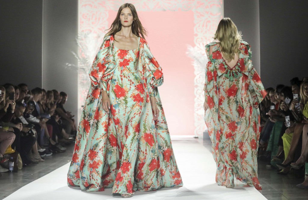 Fashion from the Badgley Mischka collection is modeled during New York Fashion Week, Wednesday Sept. 11, 2019. (AP Photo/Bebeto Matthews)