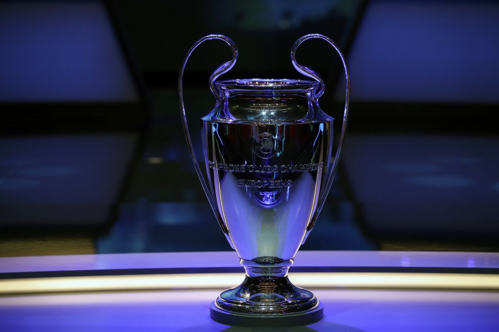 The Champions League trophy is displayed before the UEFA group stage draw at the Grimaldi Forum, in Monaco, Thursday, Aug. 29, 2019. (AP Photo/Daniel ...
