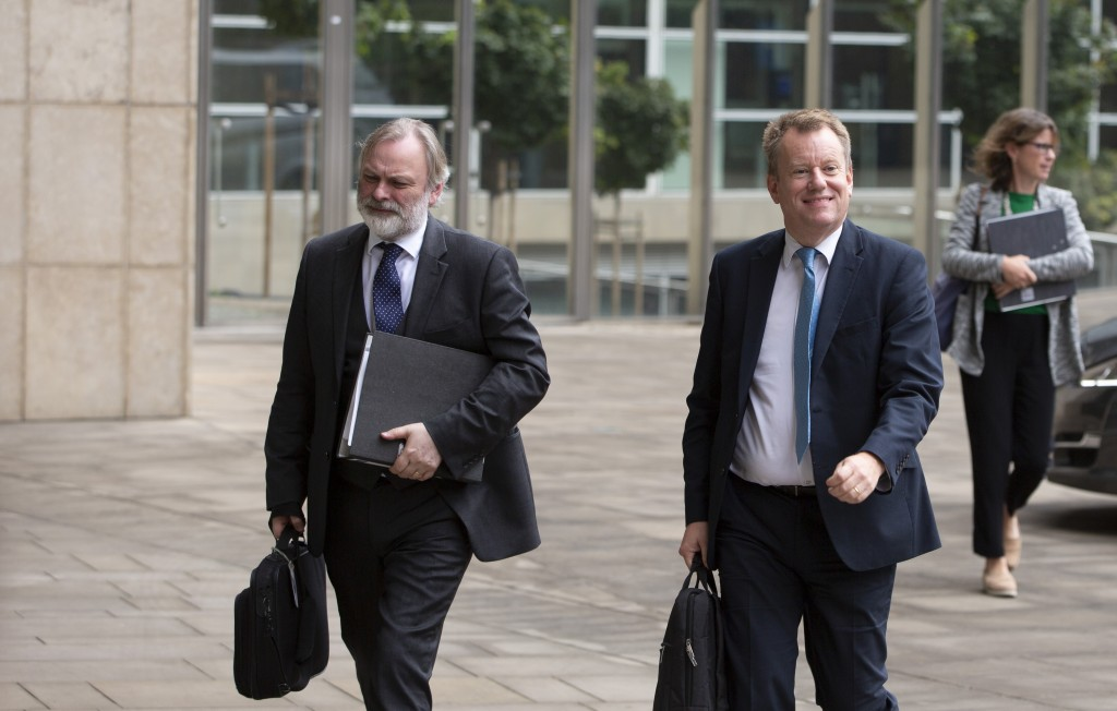 United Kingdom's Brexit advisor David Frost, right, and British Ambassador to the EU Tim Barrow arrive at EU headquarters for a technical meeting on B...