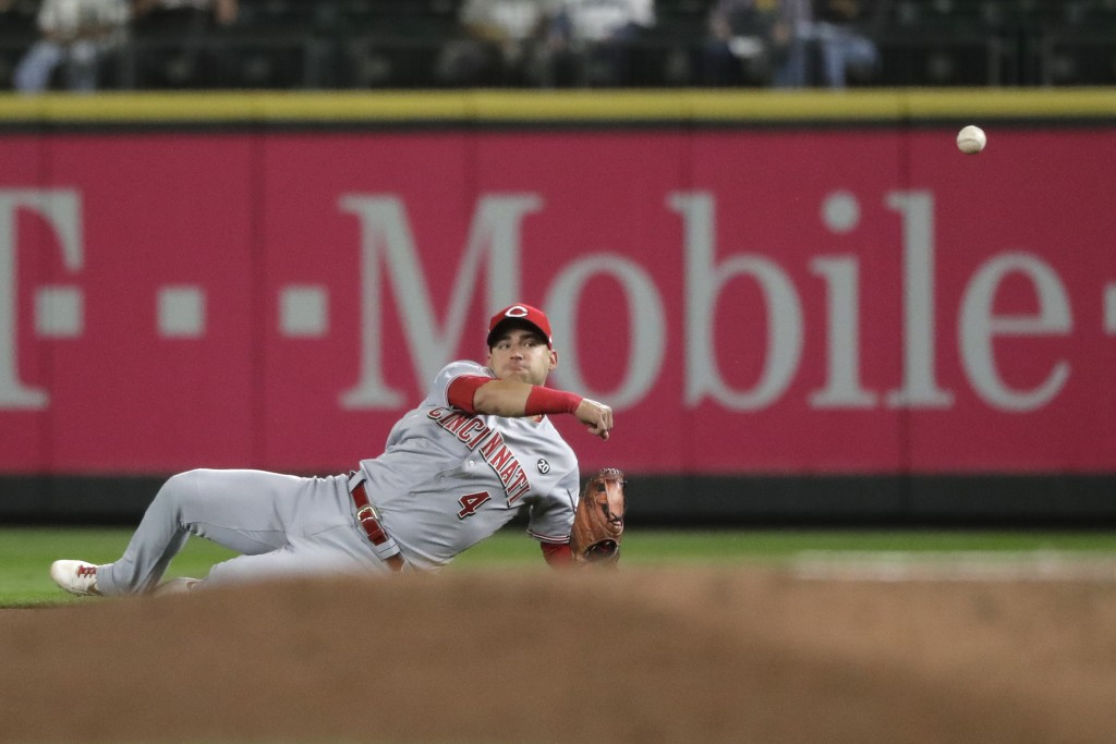Cincinnati Reds shortstop Jose Iglesias throws to first to get Seattle Mariners' Omar Narvaez out during the fifth inning of a baseball game Wednesday...