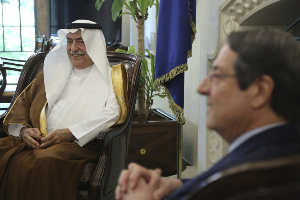 Cyprus' president Nicos Anastasiades, right, and Saudi Foreign Minister Ibrahim Bin Abdulaziz Al-Assaf talk during their meeting at the presidential p
