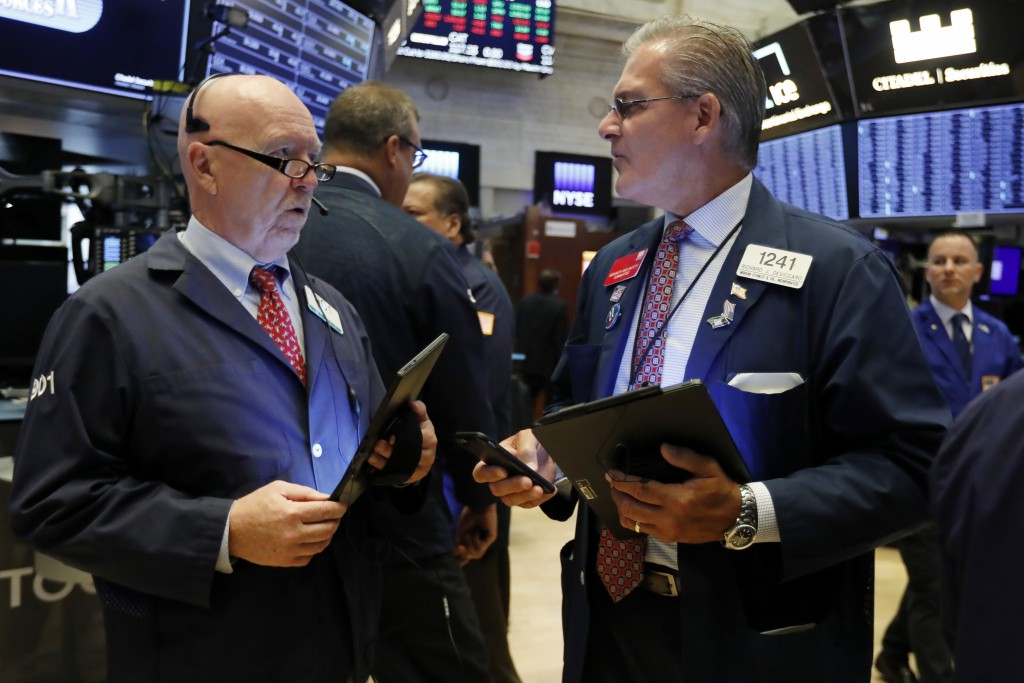 FILE - In this Sept. 4, 2019, file photo traders John Doyle, left, and Richard Deviccaro work on the floor of the New York Stock Exchange. The U.S. st
