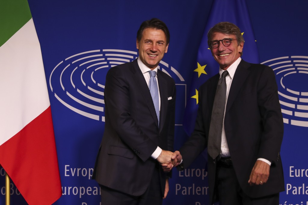 Italian Prime Minister Giuseppe Conte, left, shakes hands with President of the European Parliament David Sassoli before their meeting at the European...