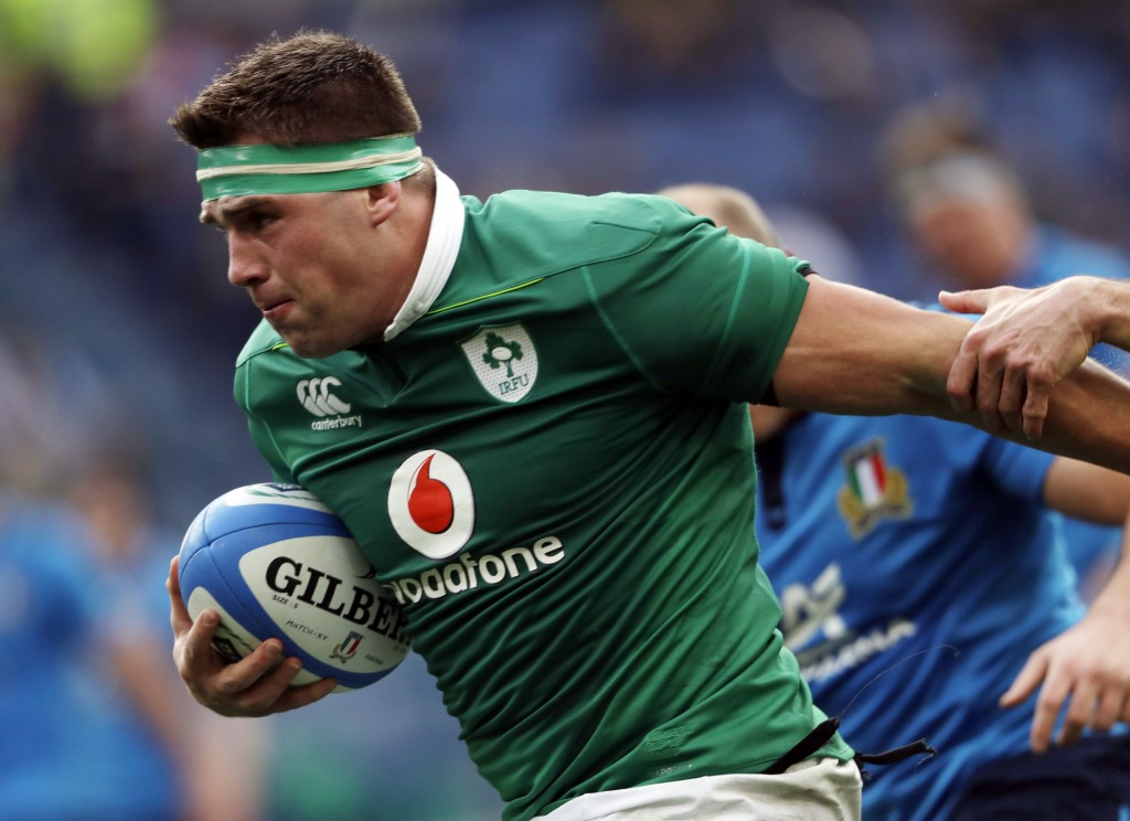 FILE - In this Saturday, Feb. 11, 2017 file photo, Ireland's CJ Stander runs on his way to score during a Six Nations rugby union international match