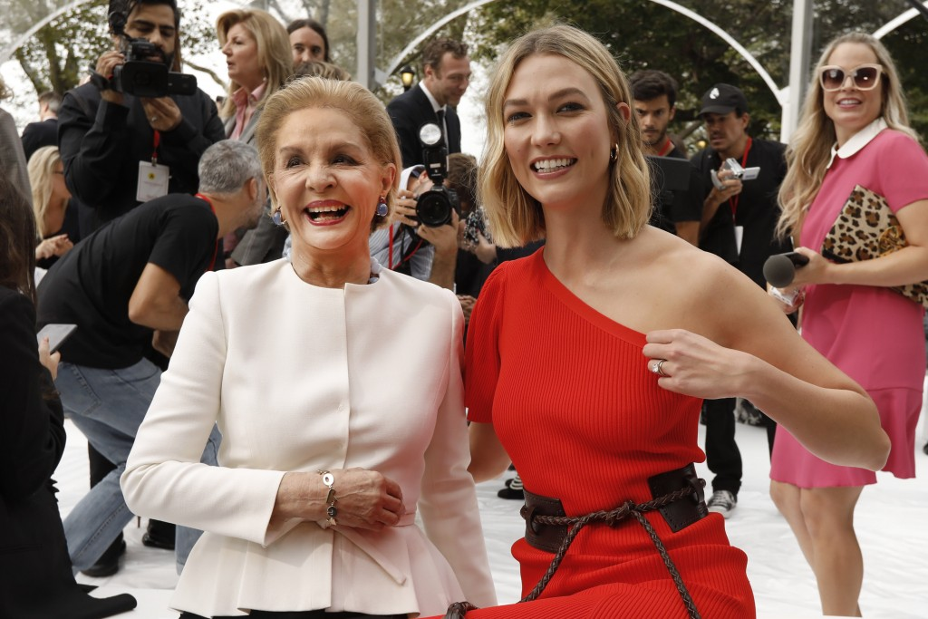 Carolina Herrera, left, poses with model Karlie Kloss before Herrera's namesake collection is modeled during Fashion Week, in New York, Monday, Sept.