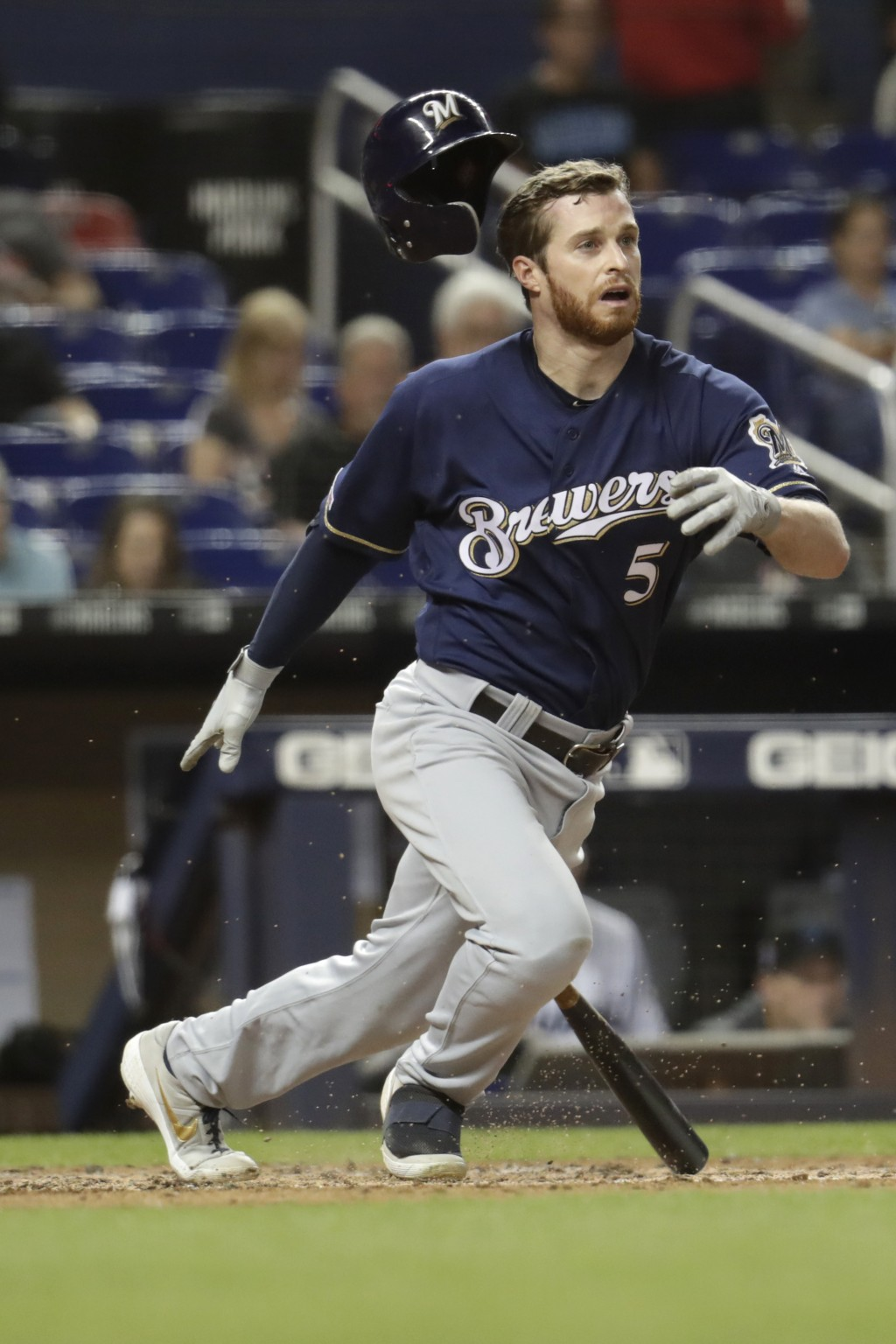 Milwaukee Brewers' Cory Spangenberg (5) loses his helmet as he grounds out to first during the fourth inning of a baseball game against the Miami Marl