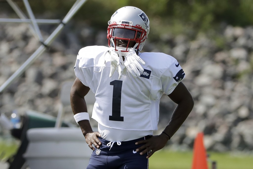 New England Patriots wide receiver Antonio Brown pauses while working out during NFL football practice, Wednesday, Sept. 11, 2019, in Foxborough, Mass