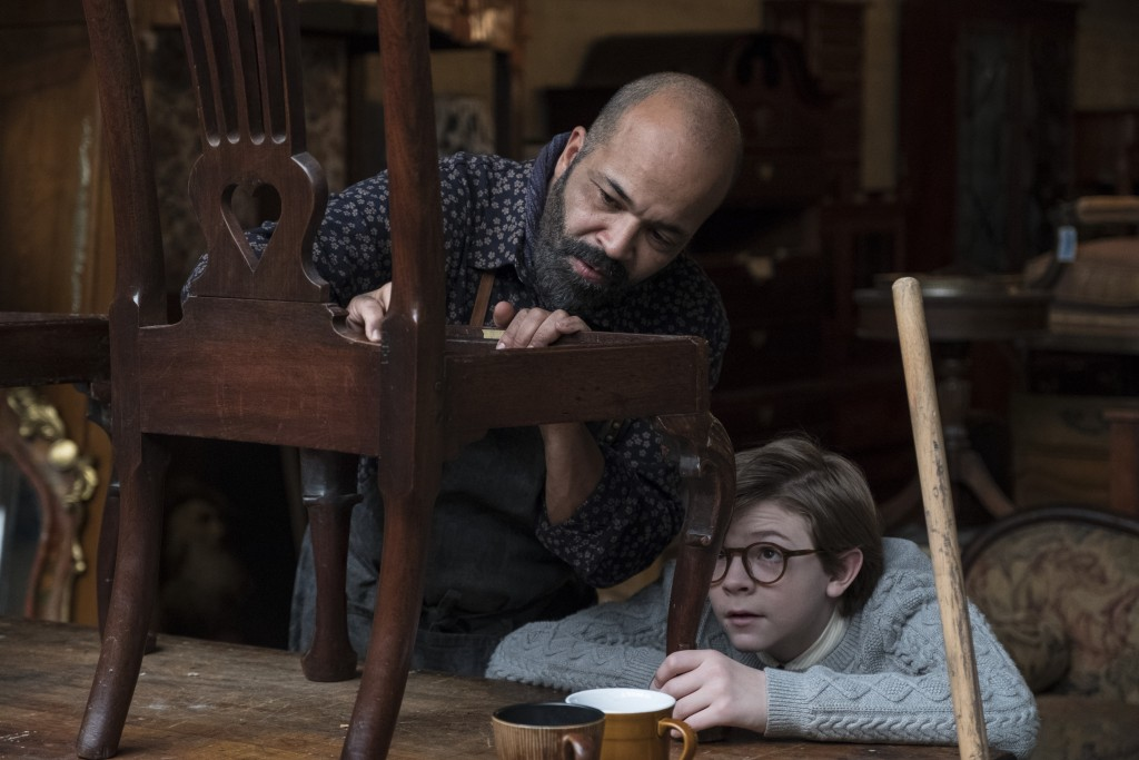 """This image released by Warner Bros. Pictures shows Jeffrey Wright, left, and Oakes Fegley in a scene from """"The Goldfinch,"""" in theaters on Sept. 13. (M..."""