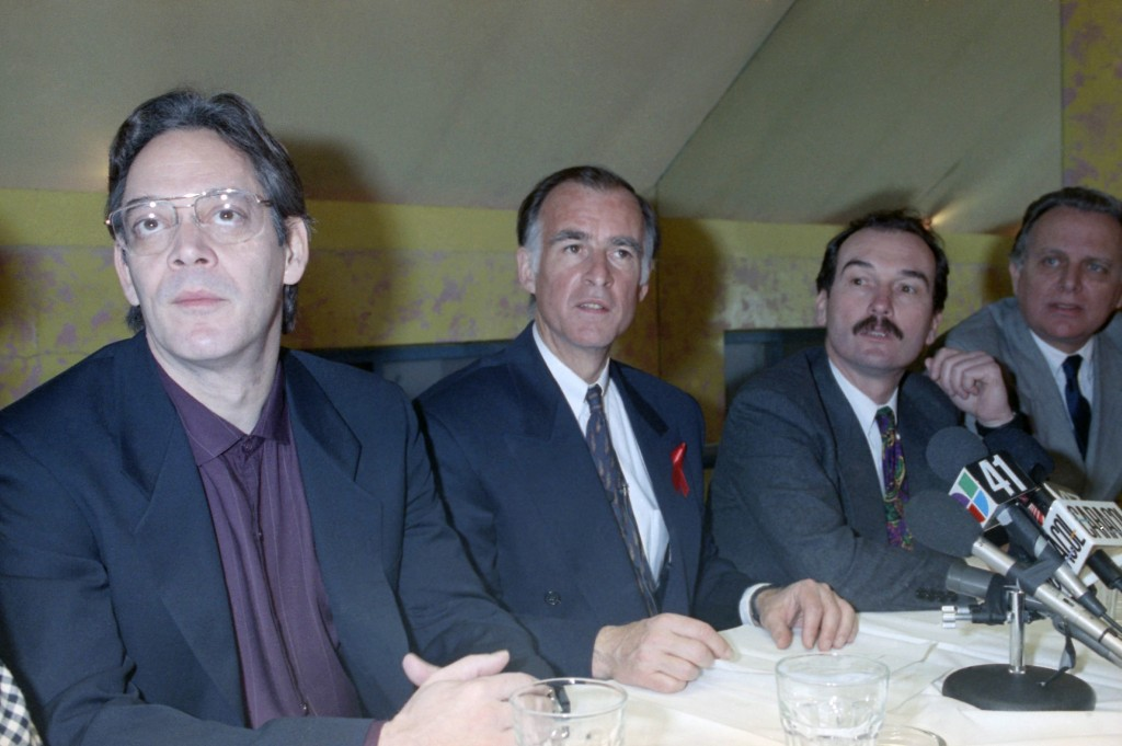 In this April 2, 1992, file photo, actor Raúl Juliá, left, listens during a meeting with Latino journalist in New York with then Democratic presidenti...