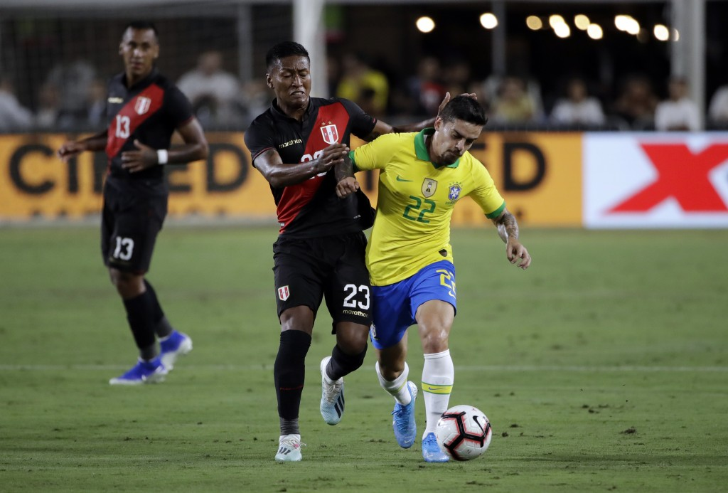 Brazil's Fagner, right, is defended by Peru's Pedro Aquino during the first half of an international friendly soccer match Tuesday, Sept. 10, 2019, in