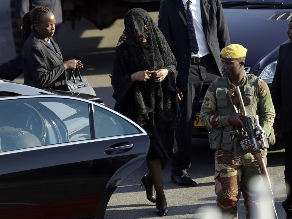 Grace Mugabe, second from left, wife of former President Robert Mugabe, attends the arrival ceremony of his remains at Robert Gabriel Mugabe Internati
