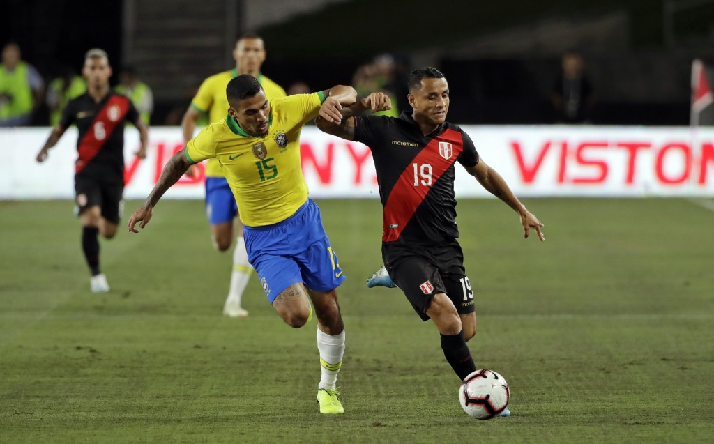 Peru's Yoshimar Yotun, right, is defended by Brazil's Allan during the first half of an international friendly soccer match Tuesday, Sept. 10, 2019, i...