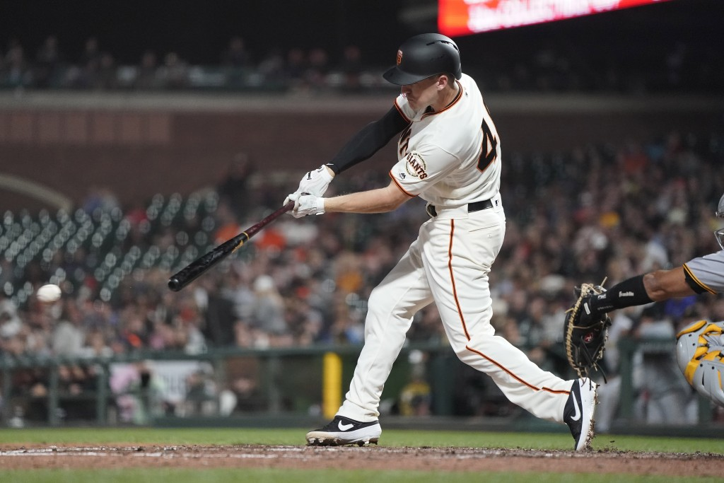 San Francisco Giants' Corban Joseph hits a grounder that scored a run against the Pittsburgh Pirates during the fifth inning of a baseball game Wednes...