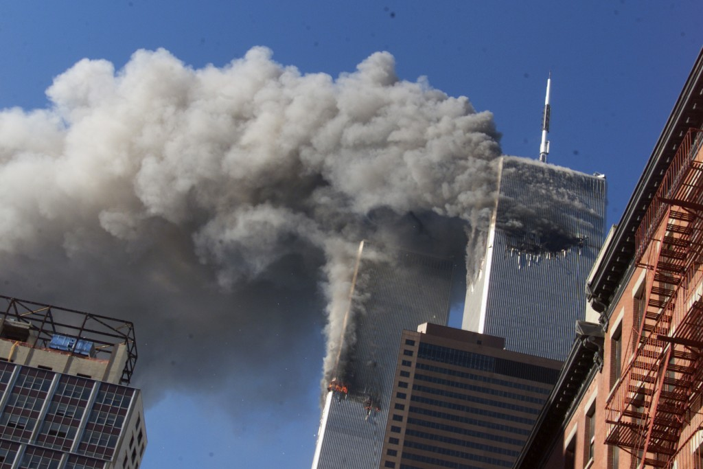 FILE - In this Sept. 11, 2001, file photo, smoke rises from the burning twin towers of the World Trade Center after hijacked planes crashed into the t