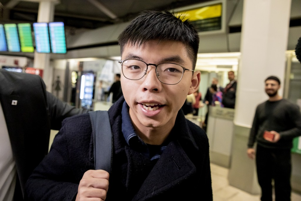 Hong Kong activist Joshua Wong carries a bag as he arrives at the Tegel Airport in Berlin, Germany, Monday, Sept. 9, 2019. Wong will address the media...