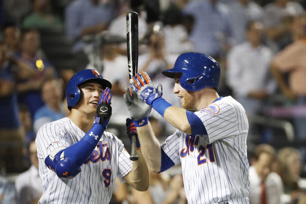 New York Mets' Brandon Nimmo (9) and Todd Frazier (21) celebrate at the plate after Frazier's solo home run during the third inning of the team's base...