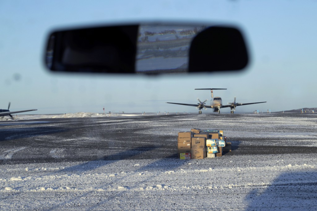 In this Feb. 19, 2019, photo, a pile of deliveries sit on the tarmac of the airport in the Native Village of St. Michael, Alaska, population 400. Tran...