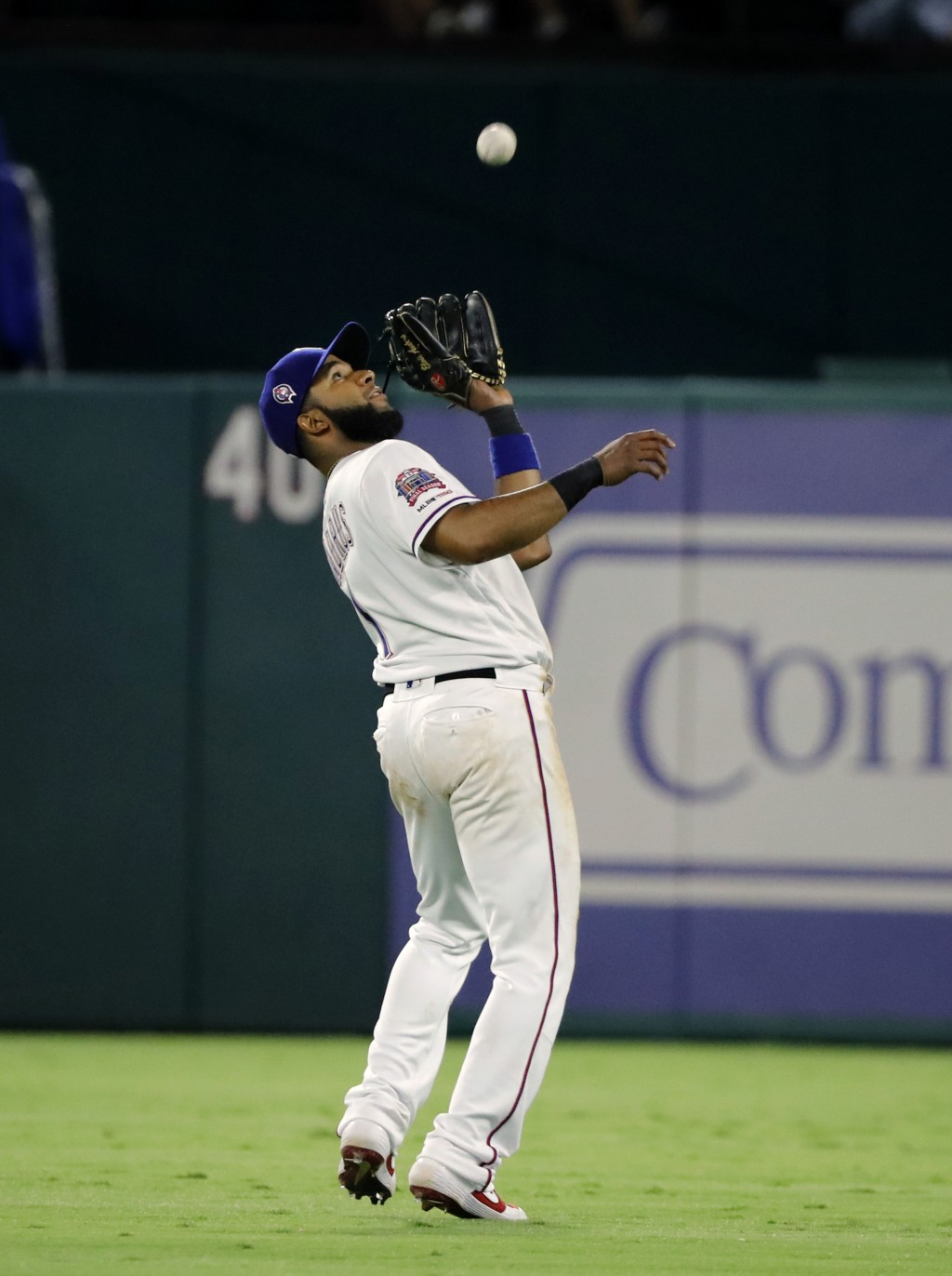 Texas Rangers' Elvis Andrus reaches up to field a fly out by Tampa Bay Rays' Joey Wendle during the fifth inning of a baseball game in Arlington, Texa