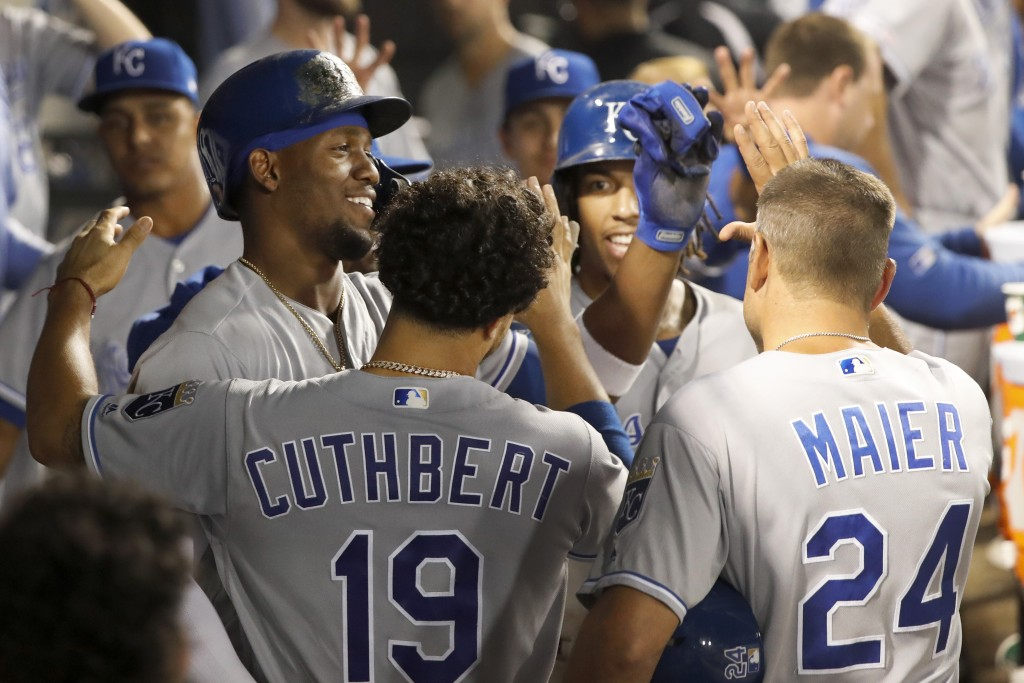 Kansas City Royals' Jorge Soler, left, celebrates in the dugout his two-run home run off Chicago White Sox relief pitcher Carson Fulmer during the eig