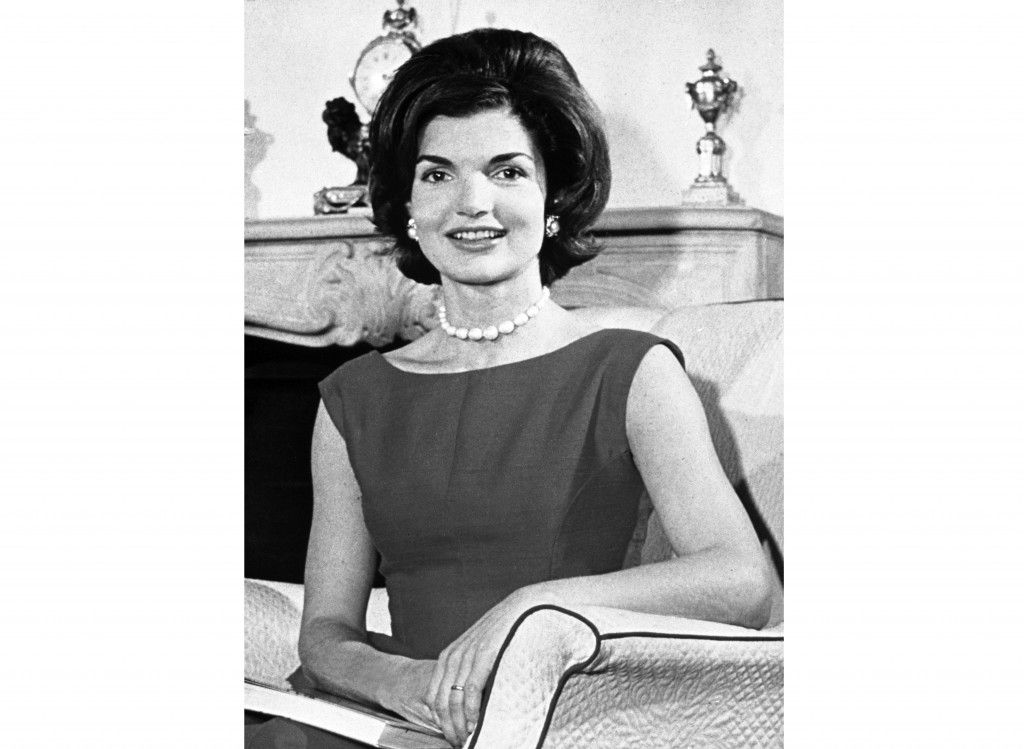 """FILE - This March 27, 1960 photo shows Jacqueline Kennedy posing in the living room of her residence in Washington, D.C. """"Camera Girl: How Miss Bouvie"""