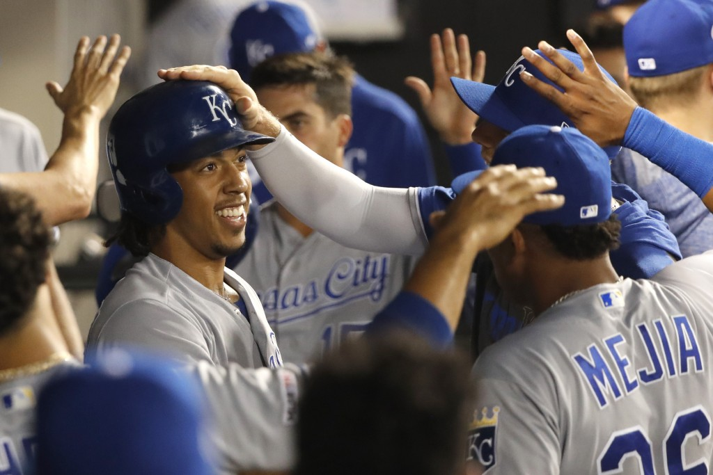 Kansas City Royals' Adalberto Mondesi, left, celebrates in the dugout after his two-run home run off Chicago White Sox starting pitcher Reynaldo Lopez...