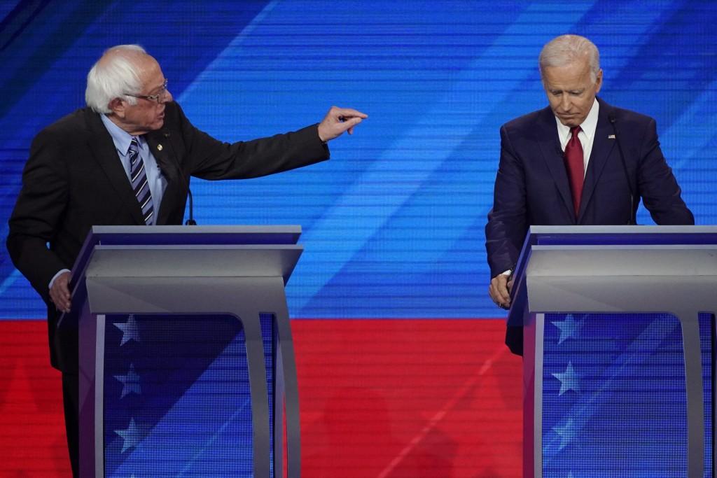 Sen. Bernie Sanders, I-Vt., left, speaks as former Vice President Joe Biden, right, listens Thursday, Sept. 12, 2019, during a Democratic presidential...